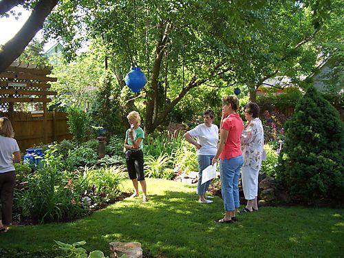 Gardeners pondering the many plants